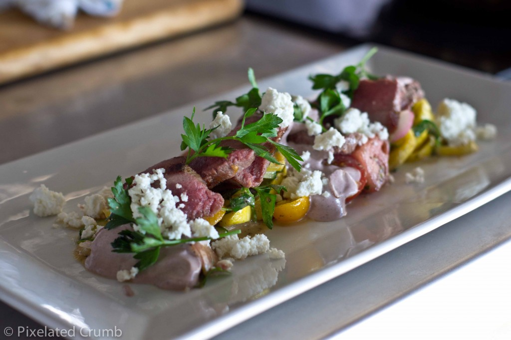 Grilled Lamb with Greek-Style Summer Squash & Tomato Salad Served with Black Olive Yogurt