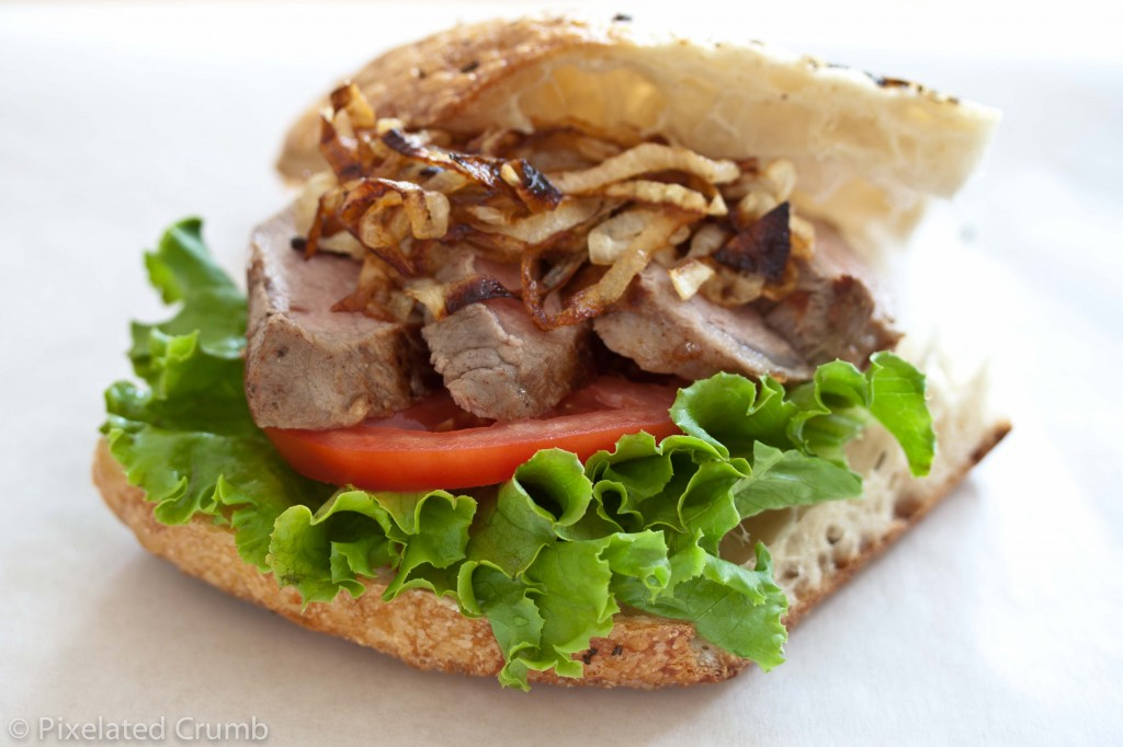 Bifana - Portuguese Sliced Pork Tenderloin Sandwich with Caramelized Onions and Garlic Aioli on Focaccia Bread