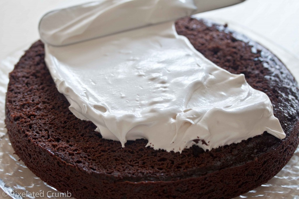 Spreading Marshmallow Frosting on Chocolate Cake