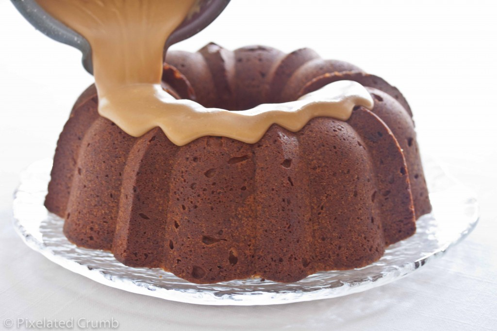 Drizzling Peanut Butter Glaze onto Chocolate Chip Peanut Butter Cake